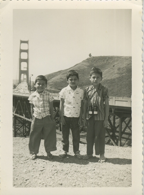Three brothers during happier times; Golden Gate Bridge