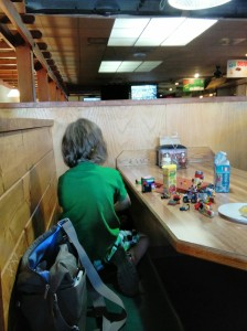 When we went to the pizza night for the reunion, he didn't want to sit at the group table so he sat behind me in a booth and spread out his Legos.  He played with them throughout the evening, having conversations with them.